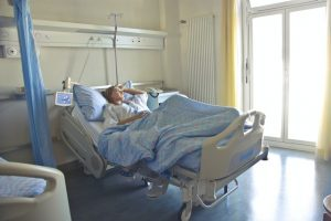 elderly woman lying in hospital bed after head injury